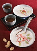 Almond soup with smoked ham and leek (Asia)