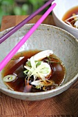 Sole rolls with vegetables in a soy broth (Asia)