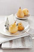 Pears poached in white wine, with goat's cheese and honeycomb