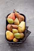 Assorted varieties of pear in a roasting tin