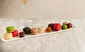 Long Platter of Various Colored Macaroons; Two Glasses of Champagne