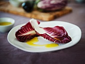 Two Radicchio Leaves Drizzled with Olive Oil