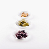Three Types of Olives in Small White Dishes