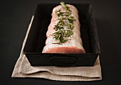 Raw Pork Roast in a Pan with Salt, Pepper and Rosemary