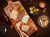 Cutting Board with Spanish Cheeses, Bread Sticks, Apples, Almonds and Red Wine