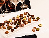 Platter of Gourmet Chocolates with Glasses of Wine