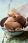 Potatoes on a jute sack in a bowl