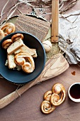 An arrangement of bread, pastries, tea and kitchen utensils