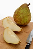 Comice pear, whole and sliced