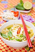 Oriental noodle soup with chicken and bean sprouts