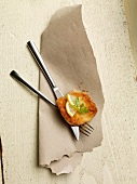 An escalope with lemon on a set of cutlery