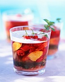 Peaches and strawberries in champagne jelly with mint