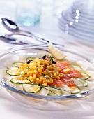 Corn salad on salmon and courgette carpaccio