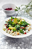 Lamb's lettuce with pears, blue cheese, pomegranate seed and pine nuts