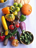An arrangement of vegetables with tomatoes, courgettes, peppers and okra
