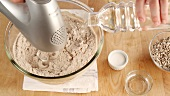 Ingredients for bread dough being kneaded with a food processor