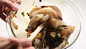 Prawns being marinated