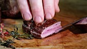 Fried beef fillet being sliced