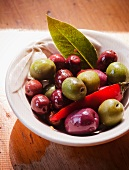 Bowl of Mixed Olives with a Chili Pepper and Bay Leaf