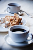 Cups of Espresso with Biscotti and Almond Nougat