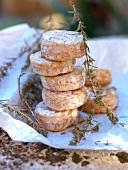A stack of soft cheese with rosemary