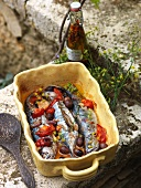 Fried mackerel with tomatoes and olives