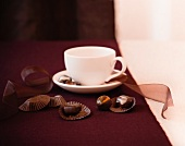 Chocolate Truffles and Wrappers with a Coffee Cup