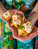 Crisps with a creamy prawn topping