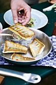 Fried zander fillets in a pan