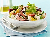 Potato salad with ham and eggs
