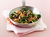 Stir-fried chicken with mushrooms and chard