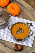 Pumpkin soup with chestnuts and pumpkin seeds