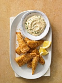 Breaded fish goujons with a dip