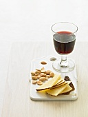 Cheese, nuts and a glass of red wine