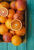 Blood oranges in a wooden crate