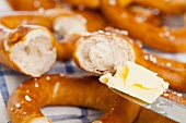 Pretzels being spread with butter