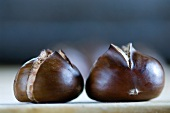 Two roasted chestnuts (close-up)