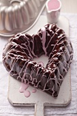 A heart-shaped chocolate and cherry cake