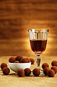 Chocolate truffles and a glass of port wine
