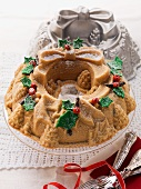 A Christmas wreath cake with the baking tin in the background