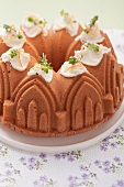 An orange sponge cake made using a cathedral baking tin