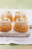 Mini Bundt cakes decorated with thyme, icing and candles