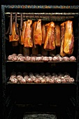 Bacon and Saumaisen (dumplings made of finely chopped salted meat) in a smoking chamber