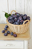 Fresh plums in a basket