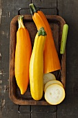 Yellow courgettes, partially sliced