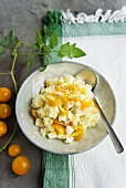 Potato salad with yellow tomatoes