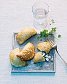 Puff pastry pockets with feta cheese and sesame seeds