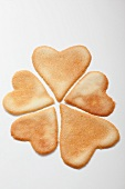 A clover leaf made of heart-shaped biscuits