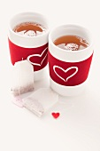Teabags and two tea cups decorated with hearts