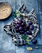 Fresh plums on a checked cloth